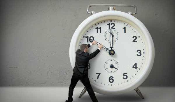 man turning back clock with shipping timesavers