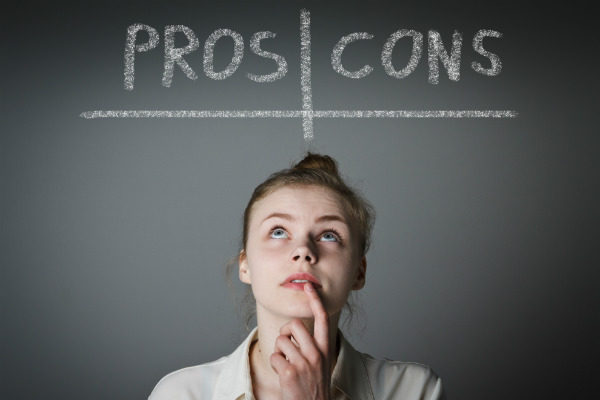 Woman looking up at pros and cons list