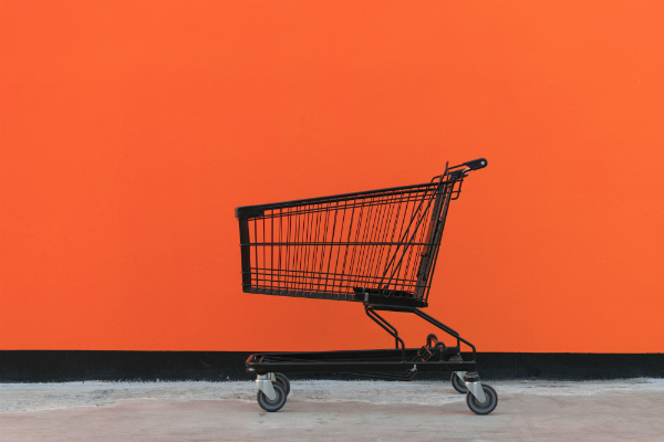online shopping cart black trolley orange background