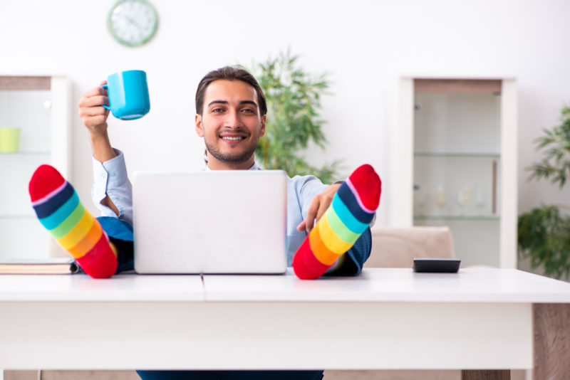 businessman in rainbow socks working from home