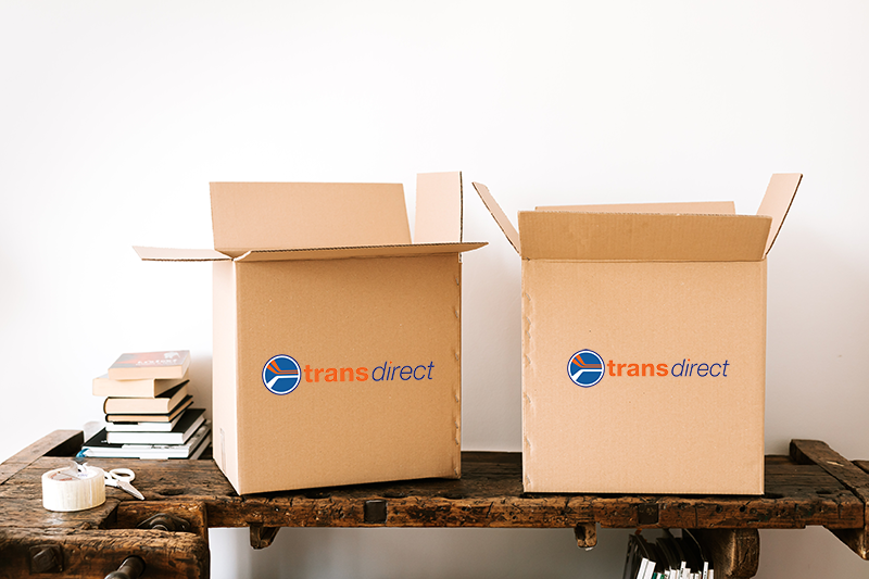 Transdirect boxes on a workbench with packaging tools
